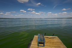 Wooden bridge on the river. Blue sky Stock Photography