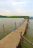 Wooden bridge in the river for take a boat Royalty Free Stock Images