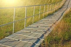A wooden bridge or a wooden road for people to cross.  royalty free stock photo