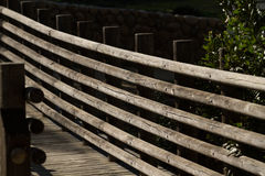 Wooden Bridge. Romantic wooden bridge crossing over a creek Royalty Free Stock Photos