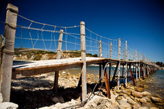 Wooden bridge with ropes Stock Image