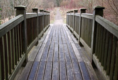 Wooden bridge into rural countryside Stock Image