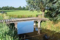 Wooden bridge in a rural landscape Stock Photos