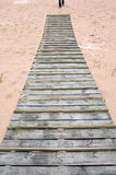 Wooden bridge on sand in sea beach Stock Image