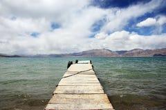 Wooden bridge into the sea Stock Photo