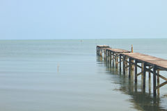 Wooden bridge into the sea Royalty Free Stock Photography