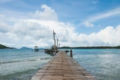 Wooden bridge into the sea. Stock Image
