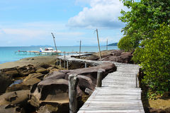 Wooden bridge at the sea Stock Images