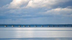 Wooden bridge in shallow waters. Low tide in Vladivostok royalty free stock photos