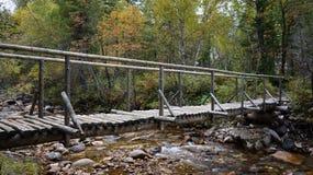 Wooden bridge Slyudyanka road forest river Khamar-Daban Stock Photography