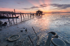 Wooden bridge and a small hut on a muddy beach. Beautiful landscape series of sunrise and sunset collection from George Town, Penang, Malaysia Royalty Free Stock Photos