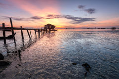 Wooden bridge and a small hut on a muddy beach. Beautiful landscape series of sunrise and sunset collection from George Town, Penang, Malaysia Royalty Free Stock Images