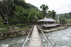 Wooden bridge in a Small town on the river in the jungle of Sumatra, Indonesia. Stock Image