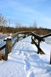 A wooden bridge with snow Stock Photo