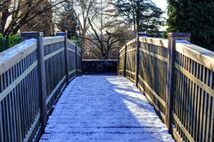 Wooden bridge with snowy surface in Queen Elizabeth Park Stock Photo
