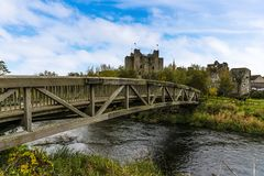 A wooden bridge spans the River Boyne at Trim, Ireland. Leading to the town and castle on a bright Autumn day Stock Photo
