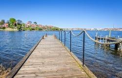 Wooden bridge on spring Swedish bay Royalty Free Stock Images