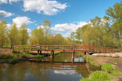 Wooden bridge in springtime stock photos