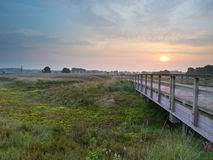 Wooden bridge during sunrise Stock Photo