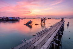 Wooden bridge sunrise in Tan Jetty, Penang. Beautiful landscape series of sunrise and sunset collection from George Town, Penang, Malaysia Royalty Free Stock Images