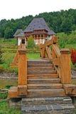 Wooden bridge to barsana monastery stock photo