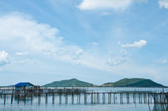 The wooden bridge to the fishery in the sea Royalty Free Stock Photo