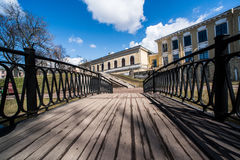 Wooden bridge to the houses. Wooden bridge to the summer houses Royalty Free Stock Photos