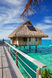 The wooden bridge to a hut over water at the ocean Royalty Free Stock Photo