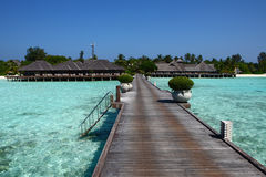 Wooden bridge to island on Maldives Stock Image