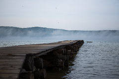 Wooden Bridge to the lake stock images