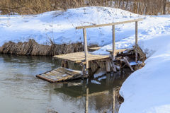 Wooden bridge to rinse clothes. Winter day Stock Image