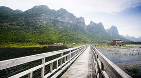 Wooden bridge to the rock mountain Stock Images