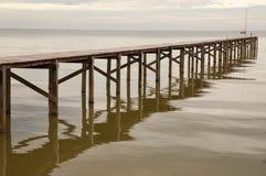 Wooden bridge in to the sea Royalty Free Stock Photos