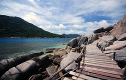 Wooden bridge to sea Royalty Free Stock Photography