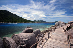 Wooden bridge to sea Royalty Free Stock Images