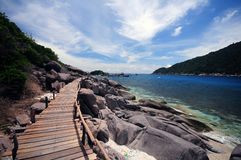 Wooden bridge to sea Stock Photography