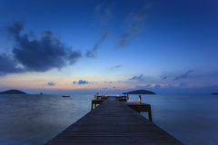 Wooden bridge to the sea in evening time Royalty Free Stock Photo