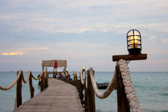 Wooden bridge in to the sea Royalty Free Stock Photos