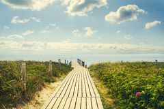 Wooden bridge to the sea. The sky with beautiful clouds. Recreation.Travel. Stock Images