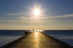Wood bridge to the sea at sunset beach in island Koh Samui, Thailand Stock Image