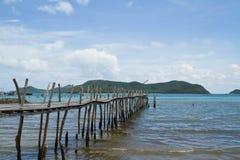 Wooden bridge to the sea Stock Photos