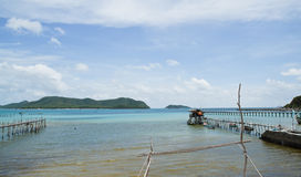 Wooden bridge to the sea Stock Photography