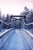 Wooden bridge to the wilderness in snow. Close-up Stock Photography