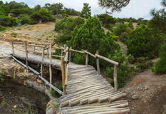 Wooden bridge on Trail Golitsyn - Falcon Path a mountain pathway carved at side of Koba-Kaya. Crimea Royalty Free Stock Image