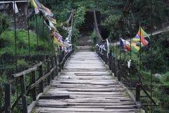 Wooden bridge. Trekking in majestic Himalaya mountains stock photos