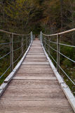 Wooden bridge the turquoise green Soca river Royalty Free Stock Photo