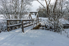 Wooden bridge under snow Royalty Free Stock Images