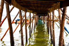 Wooden Bridge. View under wooden bridge in the ocean stock photo