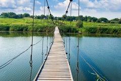Wooden bridge in a village Royalty Free Stock Photo