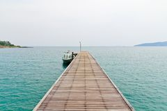 Wooden bridge to the sea. Royalty Free Stock Photography